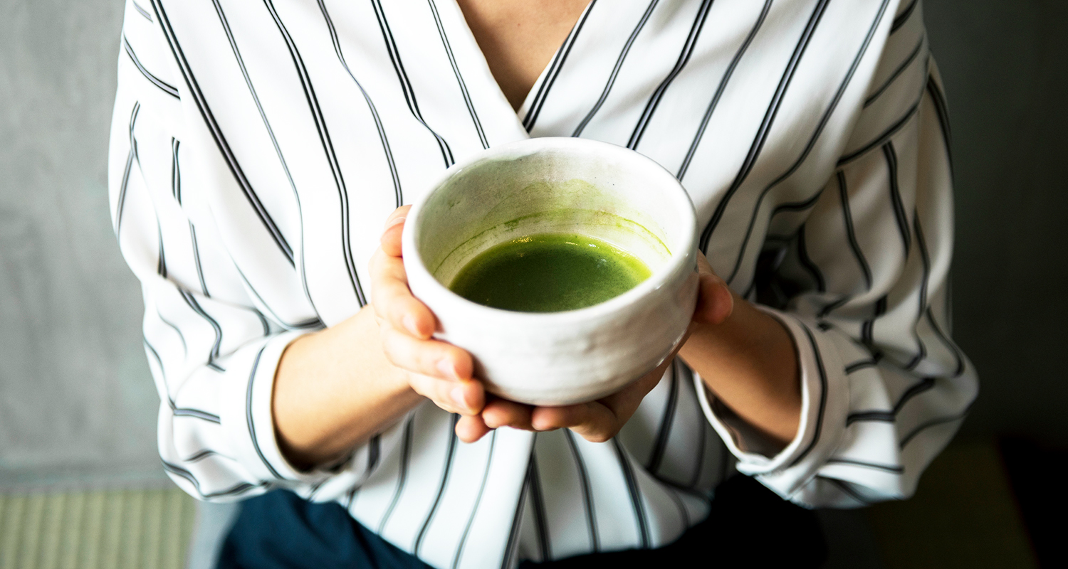 woman holding polyphenol rich green tea